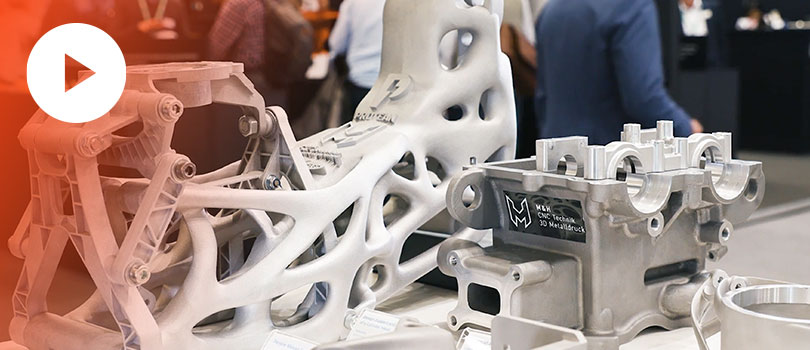 Production parts designed with topology optimization and additively manufactured with metal additive manufacturing